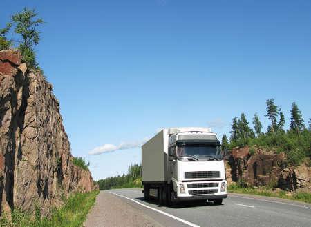 antrey: white truck on rocky highway