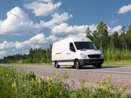 delivery van: white van on  summer country highway, landscape Stock Photo