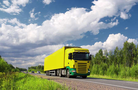 yellow  truck and cars on pictorial highway, polarized landscape Standard-Bild