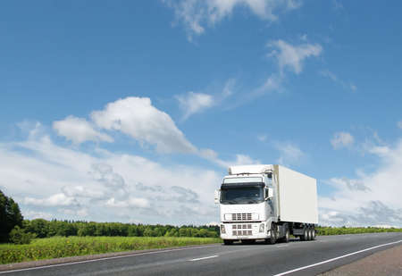 white truck on  summer country highway under blue sky, landscape