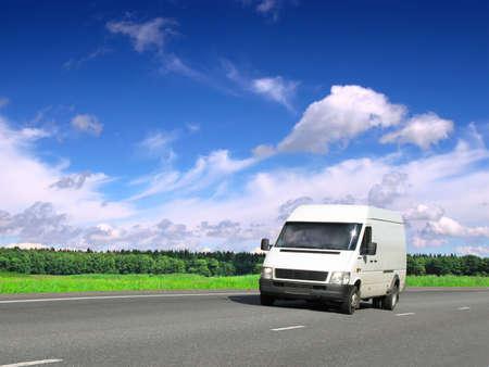white van on  summer highway under blue sky, landscape