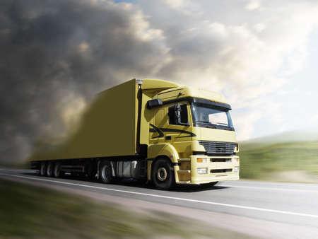 truck speeding on highway into the light