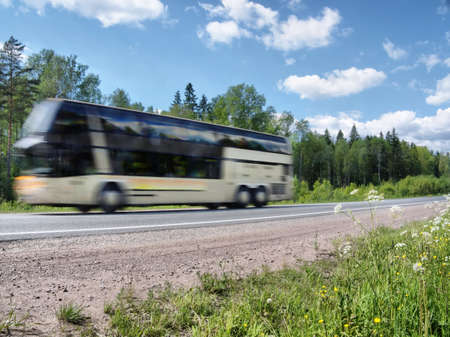 country highway: tourist bus speeding on country highway, blured in motion