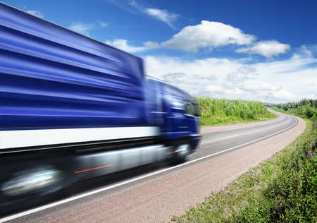 truck on highway: blue truck speeding on country highway, motion blur Stock Photo