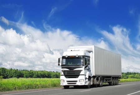 white truck on rural highway Standard-Bild