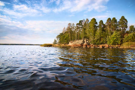 little island and  calm waves in Baltic sea, Vyborg bay