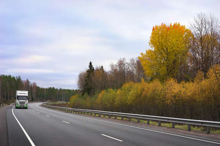 white truck and autumn trees,  highway  Scandinavia Standard-Bild