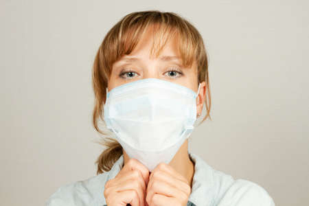 a young pretty girl during the coronavirus pandemic wears a medical mask Stock fotó