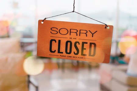 Sorry we are closed sign hang on door at coffee shop. 写真素材