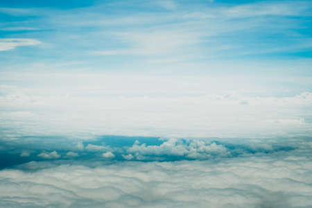 Copy space of airplane view above cloud summer blue sky and sun light abstract nature background.