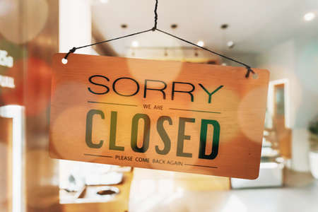 Sorry we are closed sign hang on door at coffee shop. Stock Photo