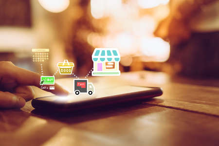 Women hand using smartphone do shopping online store with various doodle icons pop up. Social media maketing concept. 免版税图像