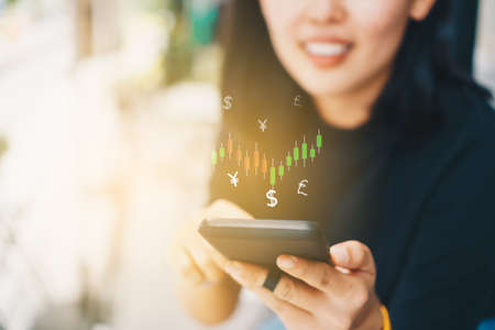 Market stock graph icon screen of smartphone background. Financial business technology freedom dream life using internet freedom life concept. 版權商用圖片