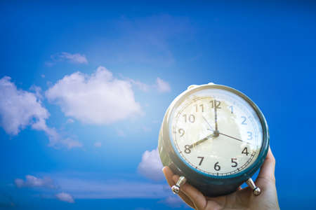 Selective focus of alarm clock with blue sky background time life concept. Stock Photo
