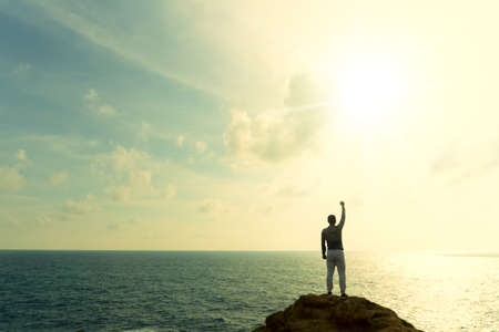 Man rise hands up to sky freedom concept with blue sky and summer beach ocean background.