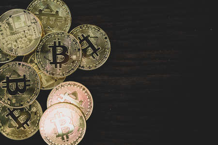 Stack of bitcoins symbol with old wood board background with copyspace that you can put text on. Stock fotó