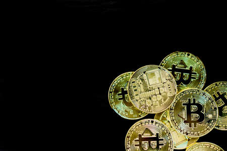 Stack of bitcoins symbol of digital money as cryptocurrency with black background with copyspace that you can put text on.