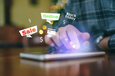 Women hand using smartphone do online selling for people or shopping online with chat box, cart, dollar icons pop up. Social media marketing black friday big sale of the year concept.
