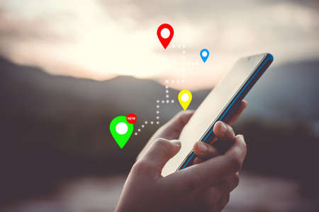 People use smartphone to check map to travel with internet and gps application for vacation or holiday.