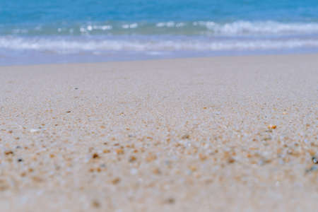 Tropical nature clean beach and white sand in summer with sun light blue sky and bokeh abstract background.
