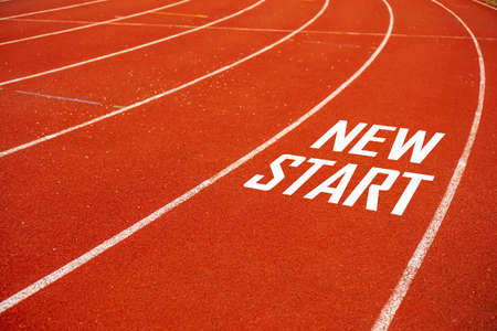 Start line on running court represents the beginning of a journey to the destination in business planning, strategy and challenge or career path, opportunity concept.