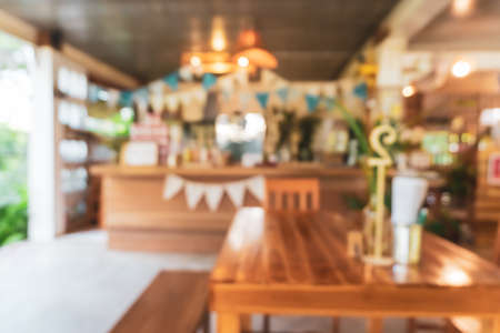 Blur coffee and restutant cafe with customers background vintage tone color style.