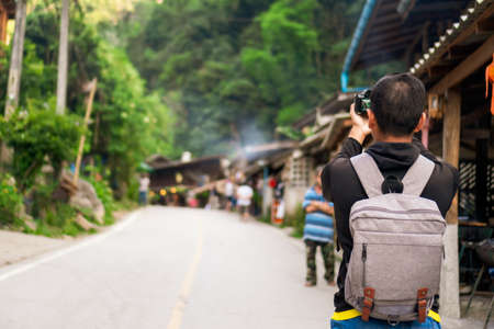 Man travel around the world with backpack freedom and relax life concept. Фото со стока