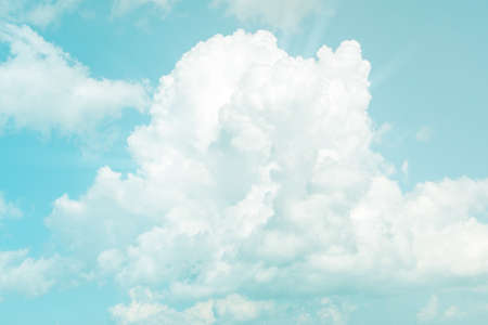 Soft sky and cloud background with a pastel color tone.