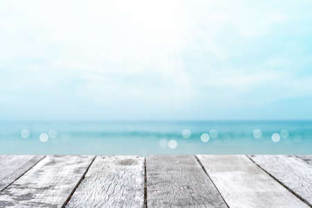 Selective focus of old wood table with blur beautiful beach background for display your product. 免版税图像 - 154744052