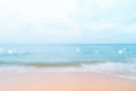 Blur tropical nature clean beach and white sand in summer with sun light blue sky and bokeh abstract  background.
