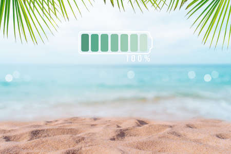 Fully charge battery 100% sign icon on natare summer beach on vacation day. Holiday long weekend relax time concept. 免版税图像 - 154743759