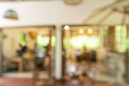 Blur coffee and restutant cafe with customers background.