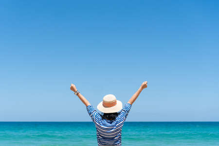 Woman travel around the world with summer beach freedom and relax life concept. 免版税图像 - 155624979