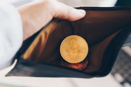 Bitcoin coin symbol of cryptocurrency digital money. Money for the future in leather wallet. Store of value or saving money in bitcoin.