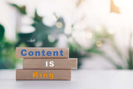 Content is king on wooden board with copy space background. Online business concept.