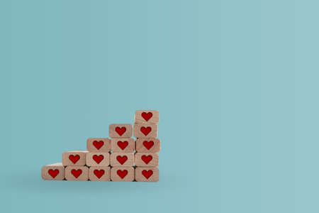 Heart icon on wooden step board with blank copy space background. Valentine love holiday concept.
