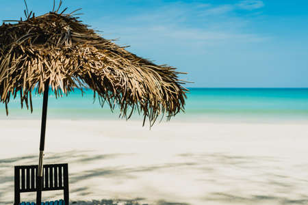 Table and chair at tropical summer beach background.