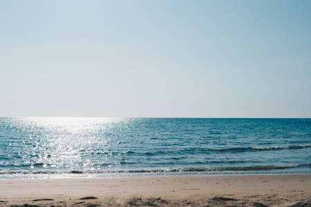 Tropical nature clean beach and white sand in summer season with sun light blue sky background. 免版税图像 - 164463720
