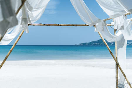 Tropical nature clean beach and white sand in summer season with sun light blue sky background.