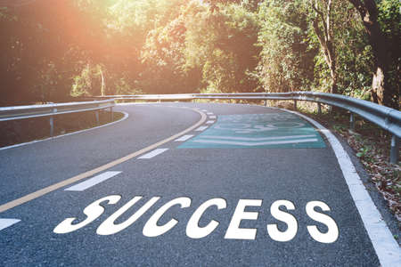 Success word on road in wood represents the beginning of a journey to the destination in business planning, strategy and challenge or career path, opportunity concept.