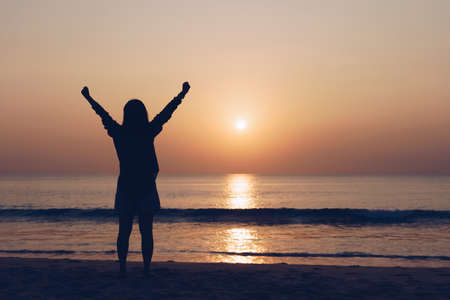 Woman travel around the world with summer sunset beach freedom and relax life concept.