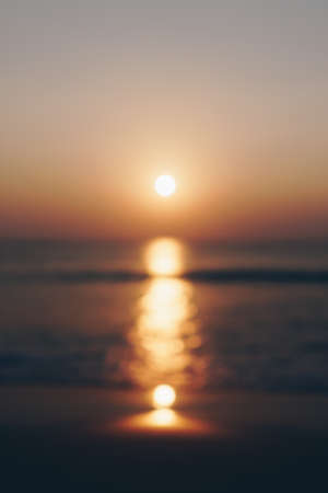 Blur tropical nature clean beach sunset sky time with sun light smartphone wallpaper background.