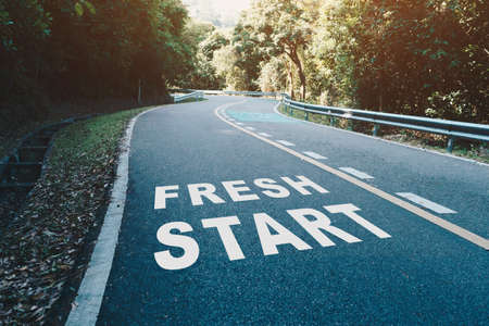 Fresh start on road lane in wood  represents the beginning of a journey to the destination in business planning, strategy and challenge or career path, opportunity concept.