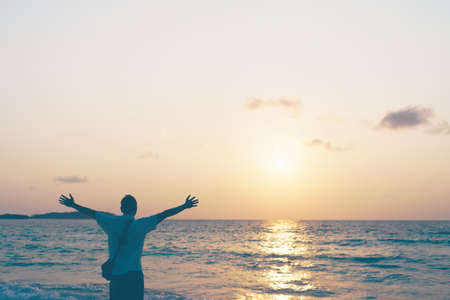 Man rise hands up to sky travel around the world with summer beach freedom and relax life.