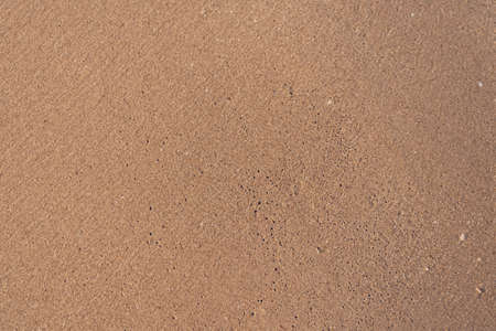 Top view of sand and sea water splash with copy space at tropical clean summer beach. Imagens