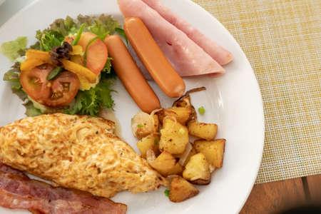 American breakfast set on old wood vintage table background.