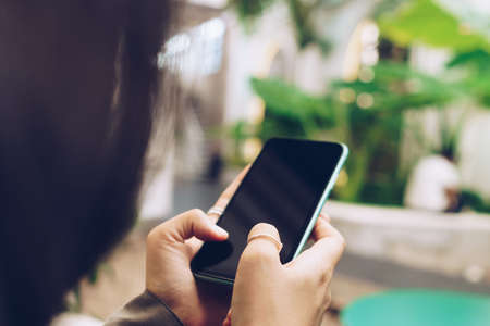 Woman hand using smartphone to do work business, social network, communication concept. Stock Photo