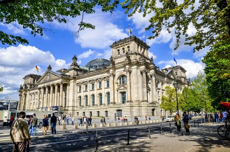 famous building: Reichstag dome on May 04 2015 in Berlin Germany. Famous building with beautiful sky and tourists during day in Berlin Stock Photo