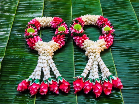Thai style garland  on green banana leaves photo