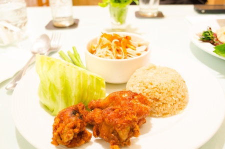 Fried chicken and rice with spicy green papaya salad, Thai cuisine photo
